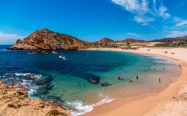 Beautiful Santa Maria beach by Cabo San Lucus has full life guarding and bathroom facilities. It is a sheltered beach that provides safe swimming and snorkeling areas. (photo via rand22 / iStock / Getty Images Plus)