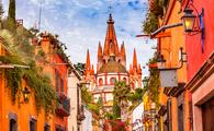 Aldama Street Parroquia Archangel church Dome Steeple San Miguel de Allende, Mexico. Parroaguia created in 1600s. (photo via bpperry / iStock / Getty Images Plus)