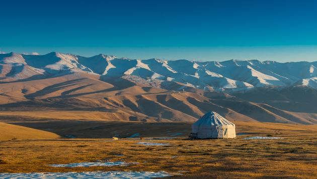 A typical yurt (temporary house)in the colourful Tien Shan Mountains in Kazakhstan. (Photo via Aureliy / iStock / Getty Images Plus)