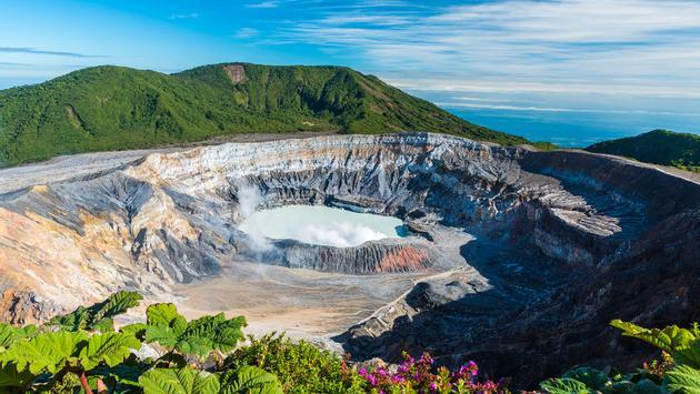 Vulcano Poas in Costa Rica - amazing crater and Landscape of vulcano (Photo via Simon Dannhauer / iStock / Getty Images Plus)