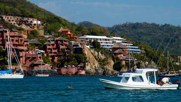 Houses along a cliffside in Zihuatanejo, Mexico (Photo via basslinegfx / iStock / Getty Images Plus)