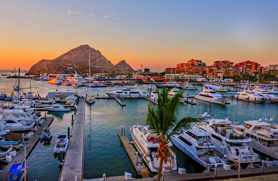 Cabo San Lucas Marina at sunset (Photo via LindaYG / iStock / Getty Images Plus)