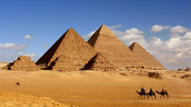 morning light on pyramids (photo via sculpies / iStock / Getty Images Plus)