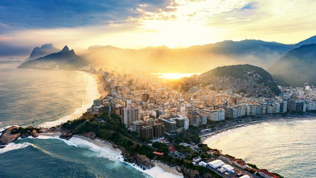 Copacabana and Ipanema beaches in Rio De Janeiro. Shot from helicopter, sunset time (photo via microgen / iStock / Getty Images Plus)