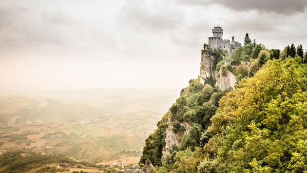 Beautiful panoramic view of the medieval fortress De La Fratta or Cesta overlooking the green hills of San Marino republic - an enclaved microstate surrounded by Italy. San Marino is the oldest sovereign state and constitutional republic in the world. (ph