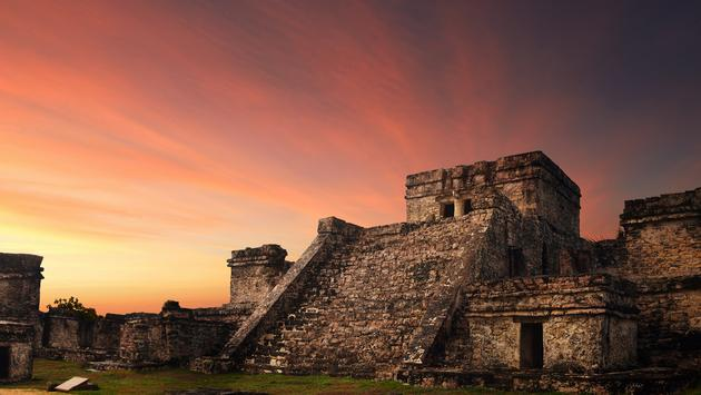 Castillo fortress at sunset in the ancient Mayan city of Tulum, Mexico (photo via Soft_Light / iStock / Getty Images Plus)