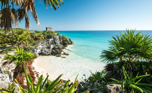 Tulum mayan ruins on the sea in yucatan mexico (photo via tommasolizzul / iStock / Getty Images Plus)