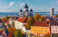 Toompea hill with tower Pikk Hermann and Russian Orthodox Alexander Nevsky Cathedral, view from the tower of St. Olaf church, Tallinn, Estonia (photo via KavalenkavaVolha / iStock / Getty Images Plus)