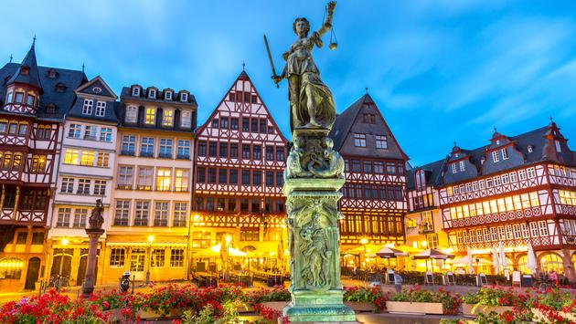 old town square romerberg with Justitia statue in Frankfurt Germany (photo via vichie81 / iStock / Getty Images Plus)