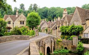 Picturesque Cotswold village of Castle Combe, England (photo via jenifoto / iStock / Getty Images Plus)