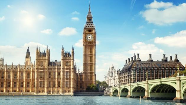 Big Ben in sunny day, London (photo via IakovKalinin / iStock / Getty Images Plus)