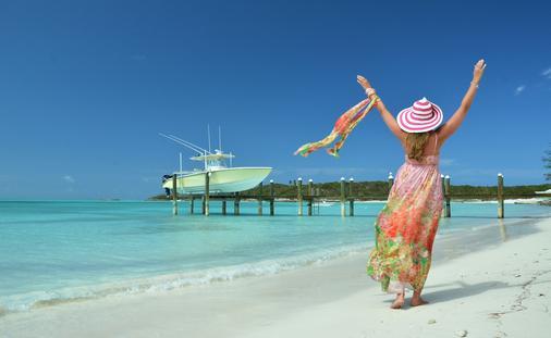 Woman on beach at Great Exuma, Bahamas (photo via astra490/iStock/Getty Images Plus)