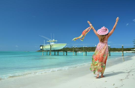 Woman on beach at Great Exuma, Bahamas (photo via astra490/iStock/Getty Images Plus)