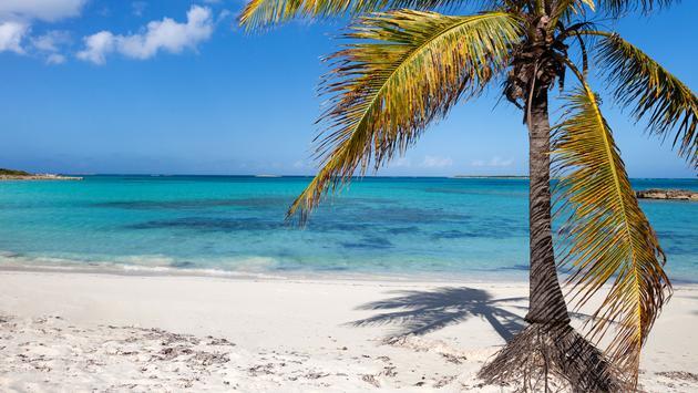 View of the beautiful tropical beach at Exuma Bahamas (photo via shalamov/iStock/Getty Images Plus)