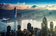 Hong Kong City and Harbor at Sunrise.  (photo via EarnestTse/iStock/Getty Images Plus)
