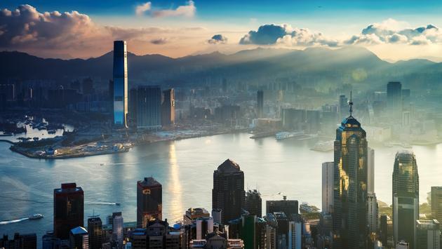 Hong Kong City and Harbor at Sunrise.  (photo via EarnestTse/iStock/Getty Images Plus)