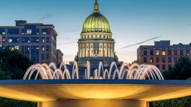 The capital building in Madison Wisconsin at dusk (photo via Dendron / iStock / Getty Images Plus)