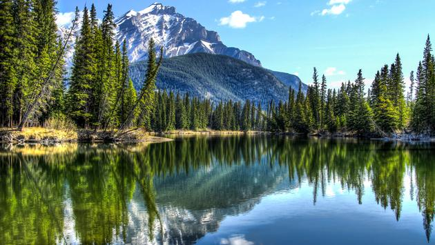 Cascade Mountain reflecting in the Bow River in Banff National Park, Alberta, Canada. (Photo via jmatkins / iStock / Getty Images Plus)
