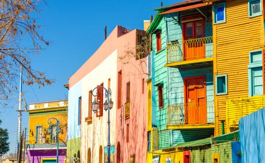 Bright colors of Caminito street in La Boca neighborhood of Buenos Aires, Argentina (Photo via DC_Columbia / iStock / Getty Images Plus)