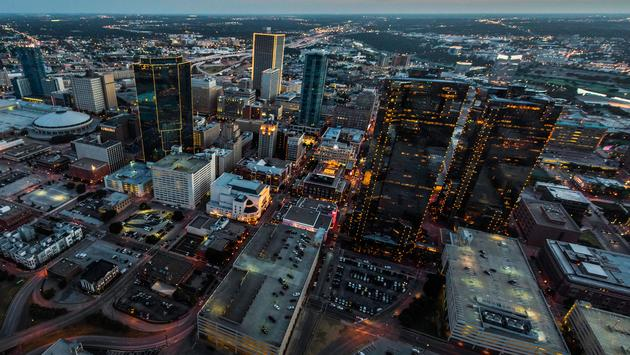 A shot from a helicopter of the city of Fort Worth, Texas at sunset. (photo via NickPacione / iStock / Getty Images Plus)