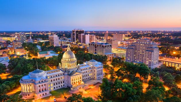 Jackson, Mississippi, USA skyline over the Capitol Building. (photo via SeanPavonePhoto / iStock / Getty Images Plus)