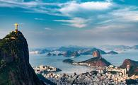 Aerial view of Rio De Janeiro. Corcovado mountain with statue of Christ the Redeemer, urban areas of Botafogo, Flamengo and Centro, Sugarloaf mountain. (photo via microgen / iStock / Getty Images Plus)