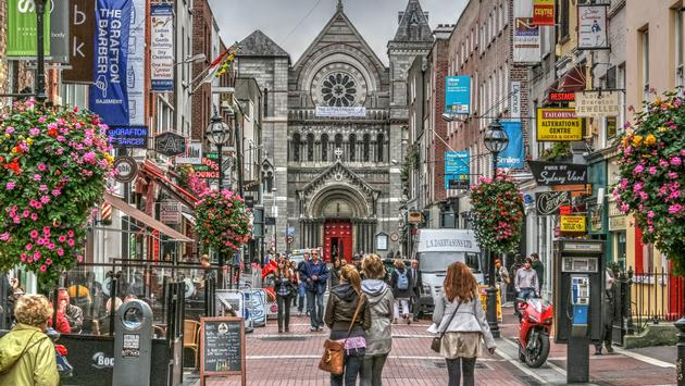 Famous shopping area in Dublin, Ireland. Grafton Street showing shoppers, shops and church. (Photo via jamegaw / iStock / Getty Images Plus)