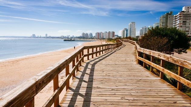 Deck at the beach in the seaside of Punta del Este (photo via brupsilva / iStock / Getty Images Plus)