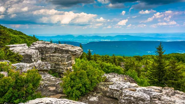 Boulders and eastern view of the Appalachian Mountains from Bear Rocks Preserve, Monongahela National Forest, West Virginia. (photo via AppalachianViews / iStock / Getty Images Plus)