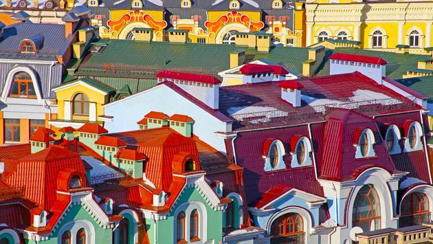 Small colored buildings in Kiev taken in Ukraine in summer (photo via al_la / iStock / Getty Images Plus)
