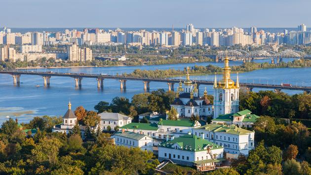 View of Kiev Pechersk Lavra, city and Dnepr river. Kiev, Ukraine. (photo via ChamilleWhite / iStock / Getty Images Plus)