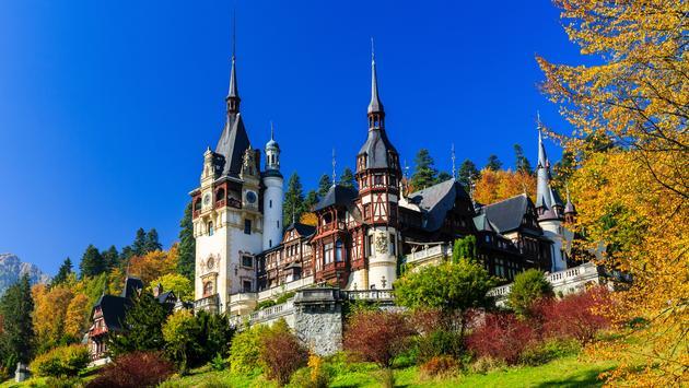 Peles castle in Muntenia region, Romania. Sinaia, Prahova county. (photo via sorincolac / iStock / Getty Images Plus)