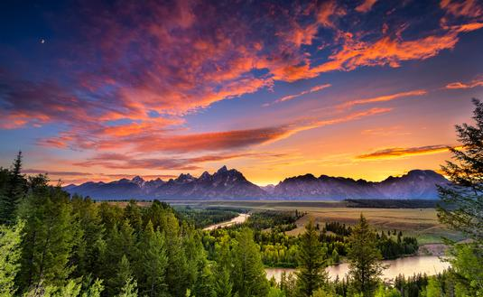 Colorful sunset at Snake River Overlook in Grand Teton National Park, WY (photo via Dean_Fikar / iStock / Getty Images Plus)