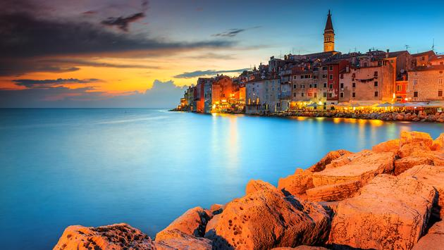 Spectacular romantic old town of Rovinj with magical sunset,Istrian Peninsula,Croatia,Europe (Photo via Janoka82 / iStock / Getty Images Plus)