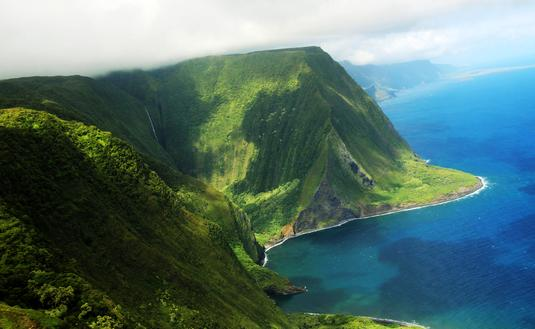 Aerial view of the coast of Molokai island and the Kahiwa Falls.