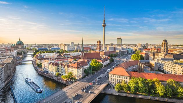 Aerial view of Berlin skyline with famous TV tower and Spree river in beautiful evening light at sunset, Germany. (photo via bluejayphoto/iStock/Getty Images Plus)