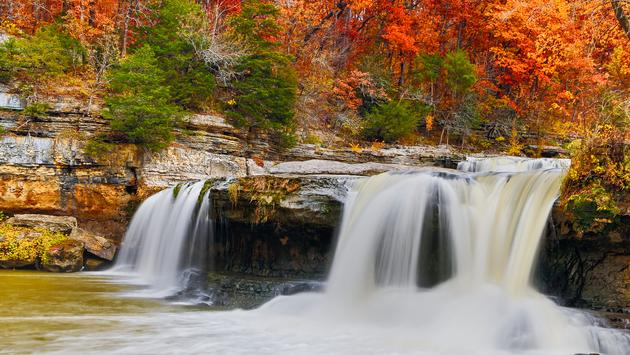 Indiana's Upper Cataract Falls is surrounded by glorious fall foliage color. (Photo via Kenneth_Keifer / iStock / Getty Images Plus)