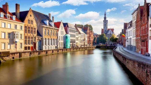 Canals of Bruges, Belgium at sunset (Photo via TomasSereda / iStock / Getty Images Plus)