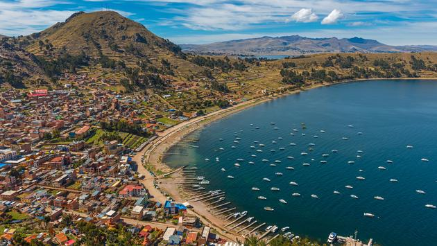 Complete cityscape of Copacabana city in the early morning seen from the Calvary Mountain by the Titicaca Lake, Bolivia, South America. (Photo via SL_Photography / iStock / Getty Images Plus)