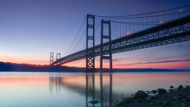 The Narrows Bridges taken at sunrise in Tacoma, WA, USA. (photo via Davin_M / iStock / Getty Images Plus)