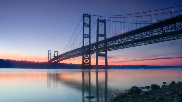 The Narrows Bridges taken at sunrise in Tacoma, WA, USA. (photo via Davin_M / iStock / Getty Images Plus)