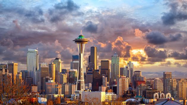 Seattle skyline at sunset, WA, USA (photo via dibrova / iStock / Getty Images Plus)