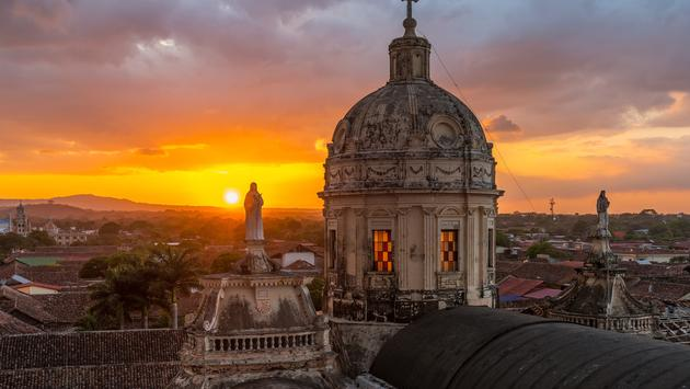 Sunset with a view over the skyline of Granada with the beautiful dome of La Merced church, Nicaragua, Central America. (SL_Photography / iStock / Getty Images Plus)