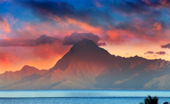 View on mountain Orohena at sunset. Polynesia. Tahiti. (photo via Konstik / iStock / Getty Images Plus)