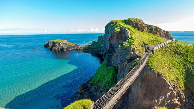 in Northern Ireland rope bridge, Carrick-a-Rede (Lauz83 / iStock / Getty Images Plus)