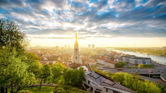 Bratislava cityscape view on the old town with Saint Martin's cathedral tower from the castle hill on the morning in Slovakia (photo via RossHelen / iStock / Getty Images Plus)