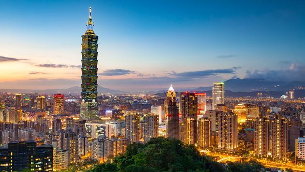 View of the Taipei Skyline with Taipei 101 at night (photo via Sean3810 / iStock / Getty Images Plus)