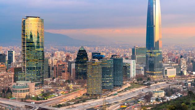 Skyline of Santiago de Chile with modern office buildings at financial district in Las Condes. (photo via tifonimages / iStock / Getty Images Plus)