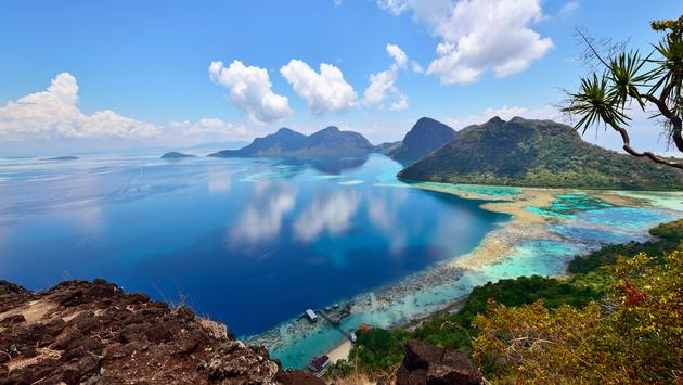 Scenic view of Bohey Dulang Islands, and ancient volcano in Tun Sakaran marine National park, Semporna, Sabah Borneo, Malaysia.  (photo via Cn0ra / iStock / Getty Images Plus)