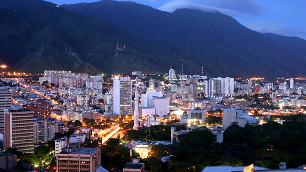 Caracas cityscape at twilight with Avila mountain behind. (Photo via Alfredo Allais / iStock / Getty Images Plus)